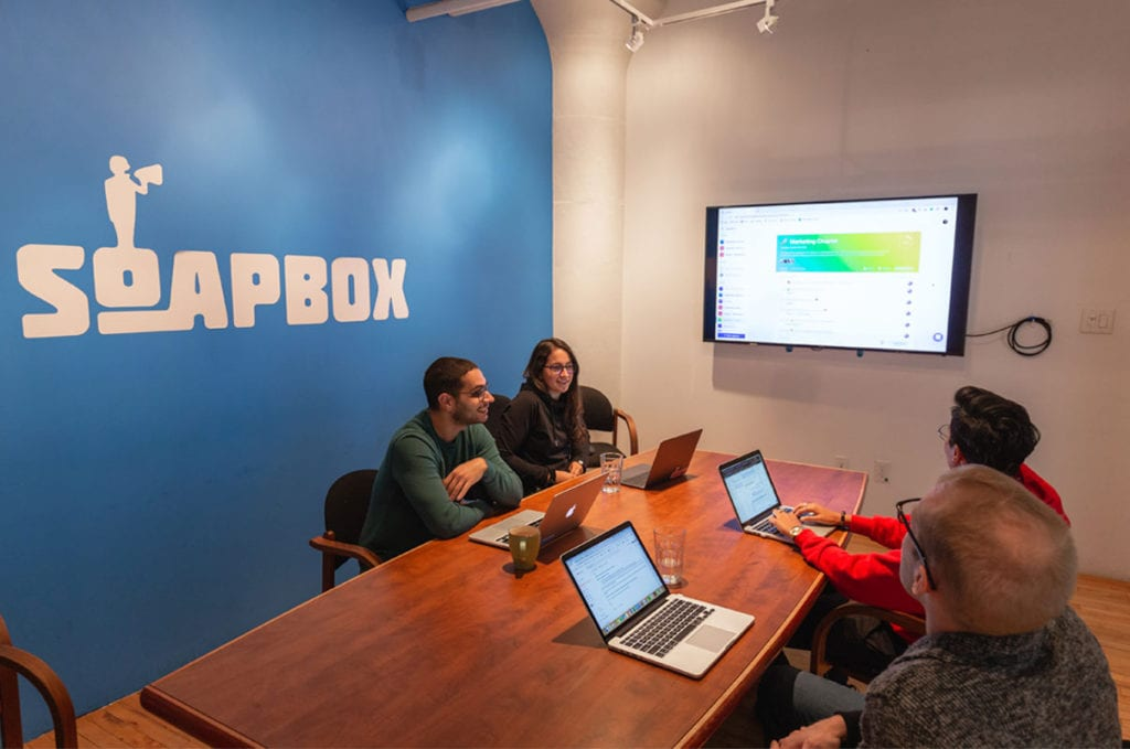 Meeting with workers using SoapBox on screen